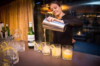 Mixxit's Amanda Humphrey serves Lore of the Land cocktails