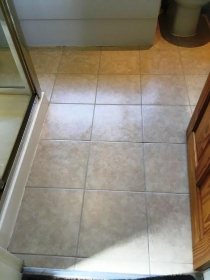 Bathroom Floor Grout After Restoration in Romiley