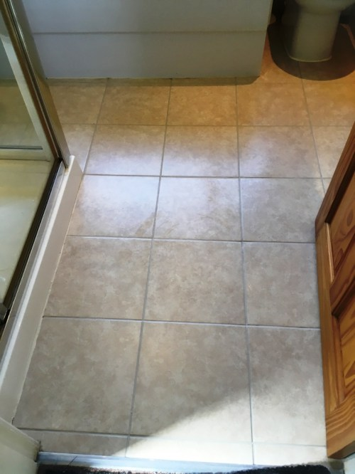 Bathroom Floor Grout After Restoration in Romiley