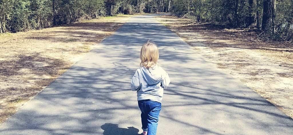 Blonde Toddler walking at Kickerillo-Mischer Preserve