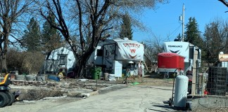 RVs are parked in the middle of the town of Malden