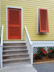 Seaside Yellow House Orange Shutters