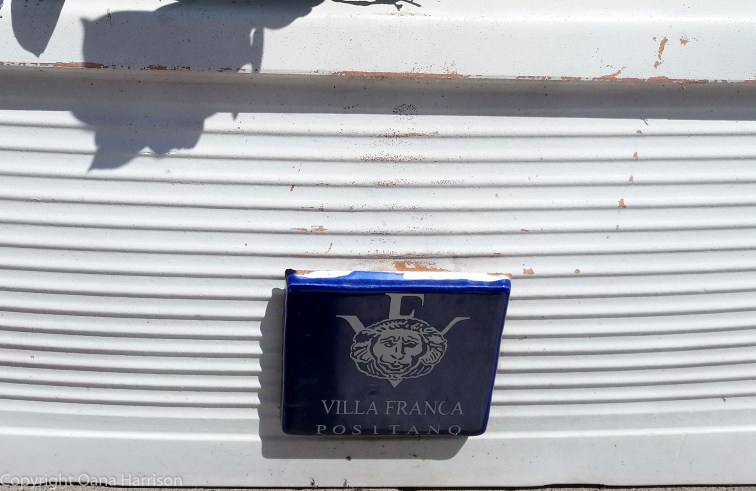 Blue tile sign in Positano
