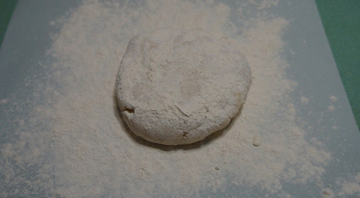 I roll-out my dough between sheets of parchment - here I have placed the larger disk on a heavily floured sheet of parchment and heavily floured the top of the disk.