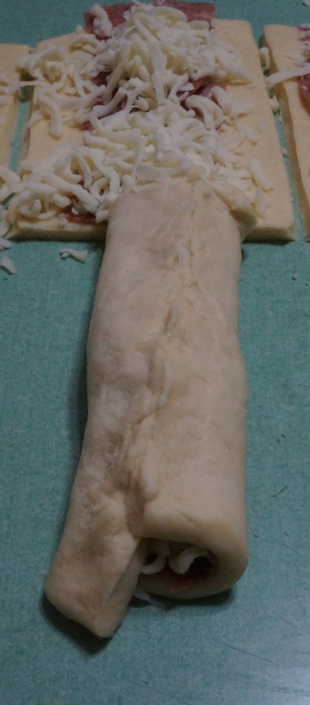 Bring-up the sides and pinch them together to form a seal lengthwise.