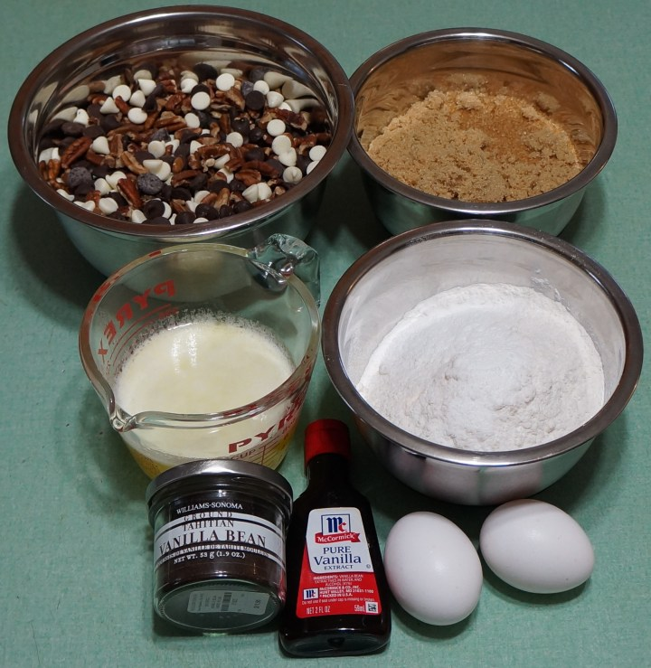 Preparation 2 - Ingredients at the ready:  nuts and chips weighed-out and mixed, light brown sugar, melted butter, flour and leavening and salt, eggs, and vanilla.