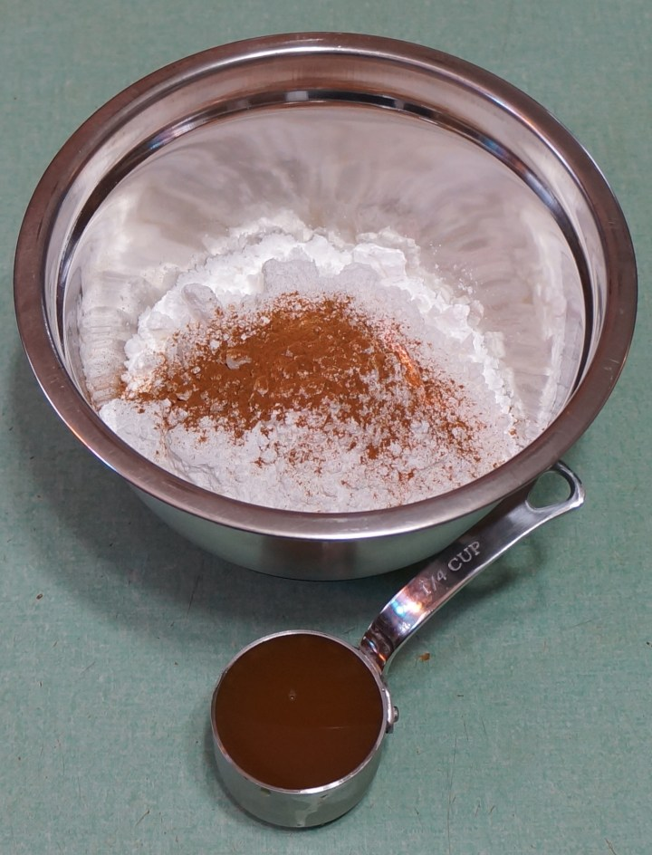 8 oz. confectioners sugar with some cinnamon (sugar and spice) + 2 oz. (1/4 cup) apple cider.