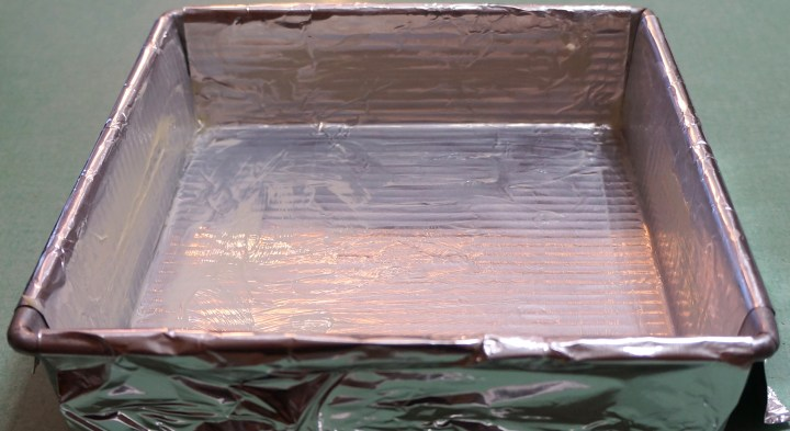 "8"" x 8"" pan - fitted with a foil sling and buttered."