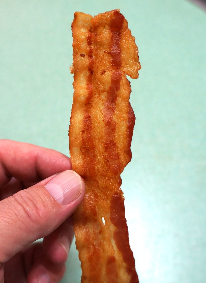 The bacon will ALWAYS come out flat and evenly cooked.  Perfection.