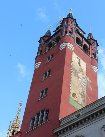 Murals decorate the facade of the building's tower