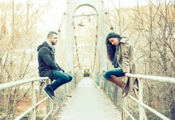 Couple Talking on Bridge