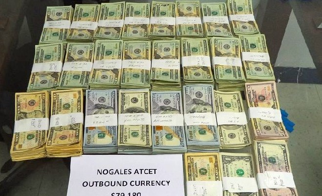 CBP in Nogales seized $79,180 on May 10, 2016, which is picture on a glass-top table in bundles.