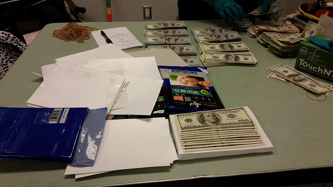 Money hidden in a traveler's bag that was not reported is photographed by CBP after seizure.