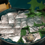 $100 bills wrapped in aluminum foil smuggled in a drum of paint seized by U.S. Customs & Border Protection