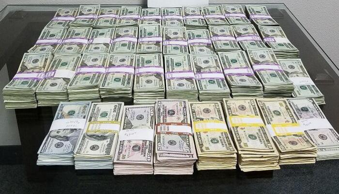 Stacks of U.S. currency seized by CBP for not being reported in the amount of $142,000