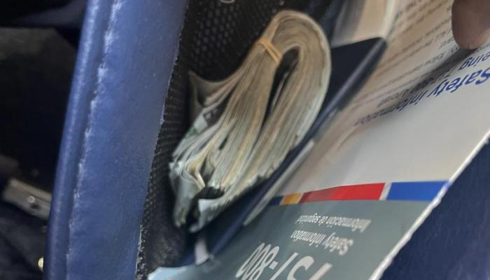 A wad of cash left behind in an airplane seat, later seized by U.S. Customs & Border Protection