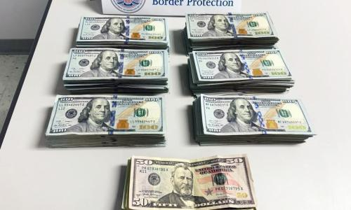 Almost $60,000 in cash stacked up and seized by Philadelphia Customs