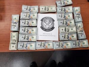 Bundles of undeclared seized cash seized by Detroit CBP