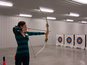 Woman shooting recurve bow