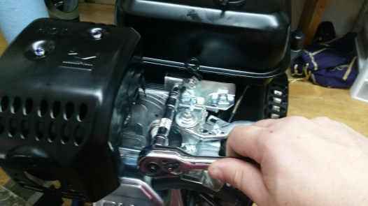 Remove 10mm bolt on front of the tank