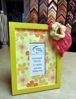 Yellow frame with flower fabric.