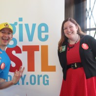 Chris Strub joins Sarah Willey for a picture with the #GiveSTLDay logo.