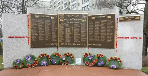 Memorial wall beside monument lists Guelphites who died