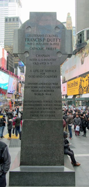 Father Duffy's honours listed on back of Celtic cross