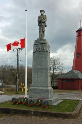 Paisley, Ontario monument in village square. Paisley names listed under village crest