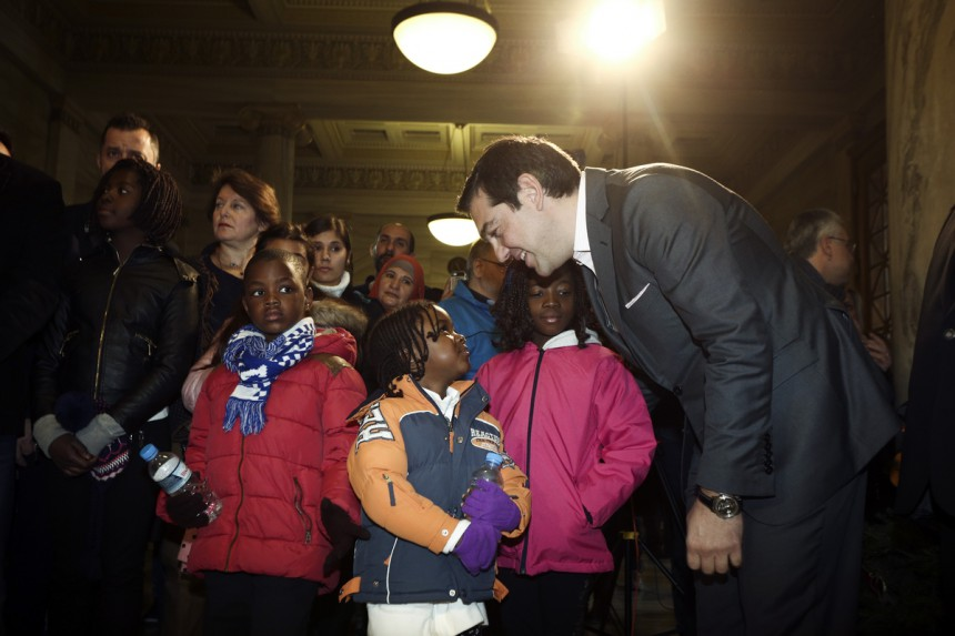This is our Great #Greek Surplus, said @tsipras holding the #refugee kids in his arms