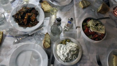 What a terrible pic of one of the best things I ate in Greece! We went to dinner with a childhood friend of my husband's and his really nice wife. He ordered this incredible eggplant dish (top left). It was so well seasoned and delicious. I wanted to go back there before we left, but ran out of time. That was sad. You married a good man Yiota! :-)
