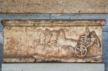 Marble sculpture of chariot and apobates at the ancient Agora museum
