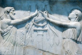 Relief statue of a ritual at the Archaeological Museum of Piraeus