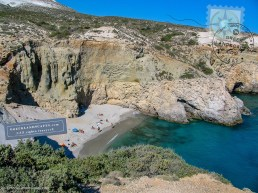 Sandy beach and colorful volcanic deposits
