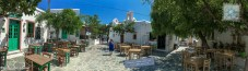 Cobblestone street with restaurant tables