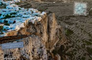 White cubist homes over steep cliff face