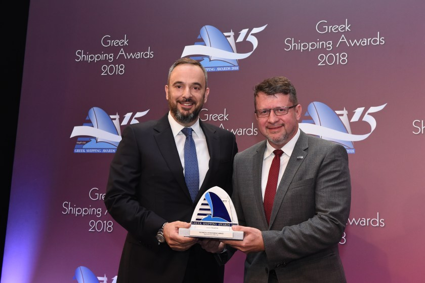 Kostas Fanouriadis of Farad S.A. accepting the Technical Achievement Award from Ioannis Chiotopoulos of sponsor DNV GL.