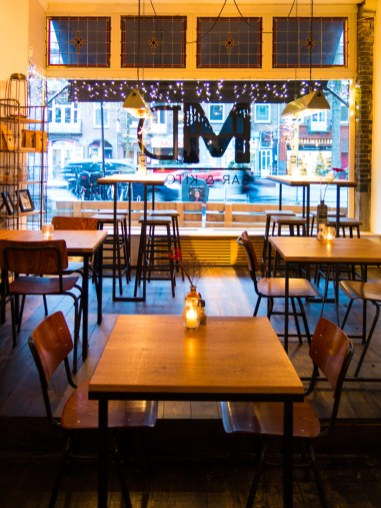 Meatless District Vegan Restaurant Amsterdam inside interior tables