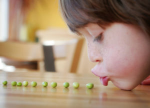 child eating healthy vegetables