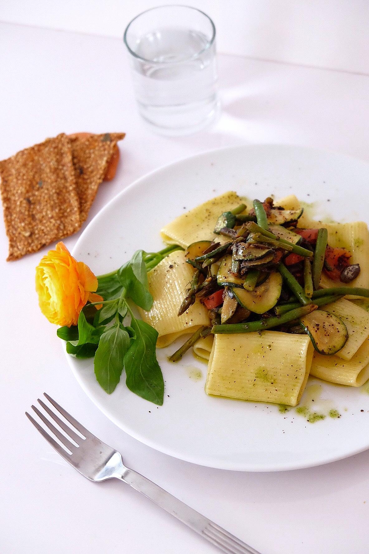 Pasta with homemade green pesto and seasonal vegetables