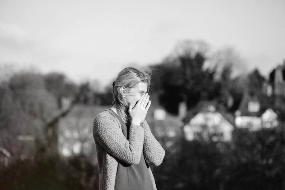 A young lady getting emotional during proposal by London wedding photographer