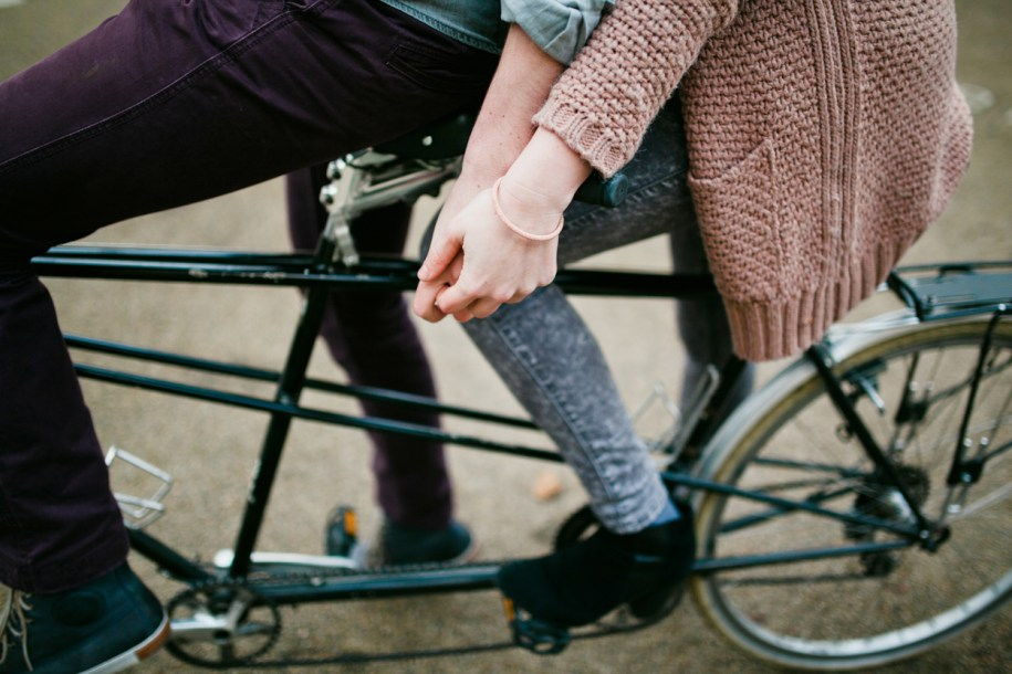 Greenwich park proposal photo shoot on a tandem bike by london wedding photographer