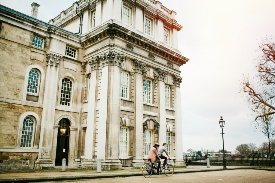 Couple riding on a tandem bike in Greenwich naval college by greenwich wedding and portrait photographer