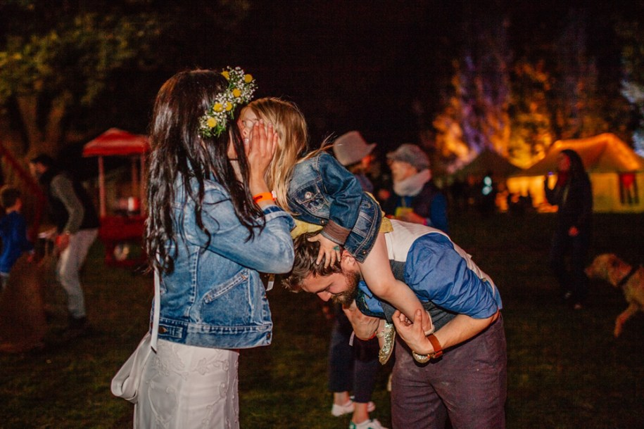bride kisses her daughter at their festival wedding in hawarden