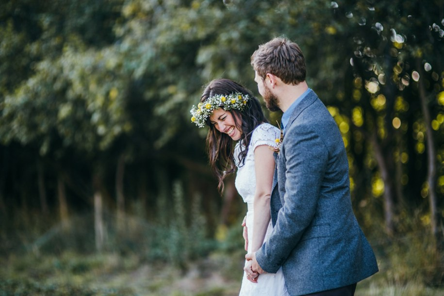 bride and groom laughing at a festival style wedding by Hawarden wedding photographer