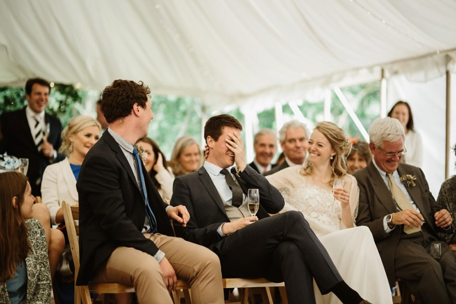 guests laughing at a marquee wedding in Oxfordshire