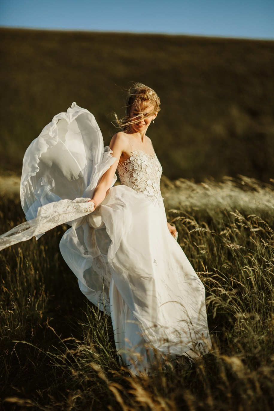 bride blown by the wind on white horse hill