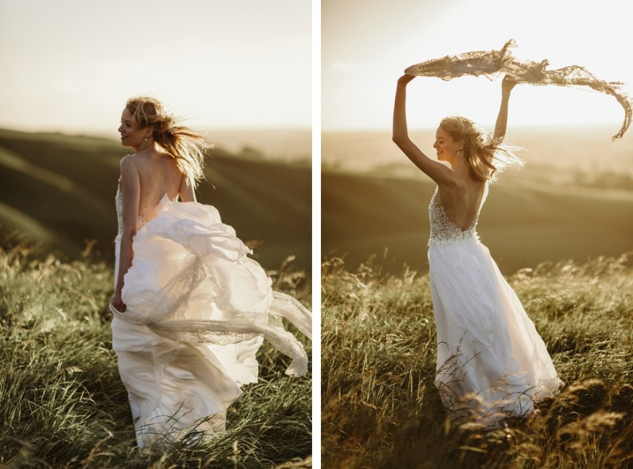 bride wearing a custom made wedding dress on a hill in Oxforshire