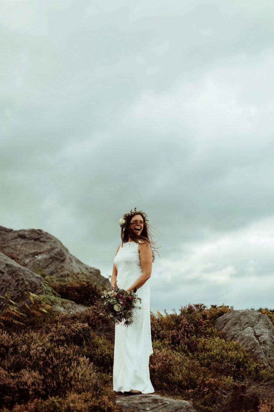 Boho bride among the rocks in Northumberland