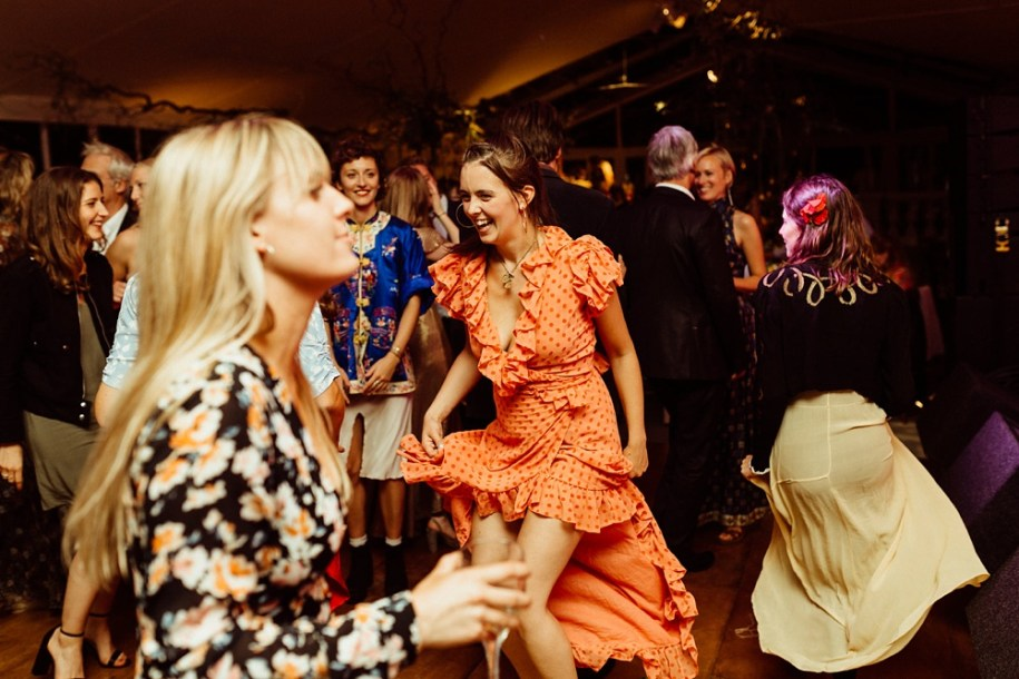 wedding guests laughing and dancing for New Forest wedding
